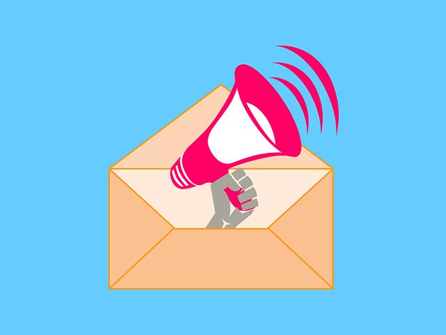 illustration of hand holding megaphone emerging from envelope
